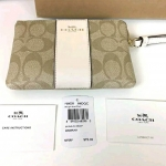 COACH F58035 CORNER ZIP WRISTLET IN SIGNATURE COATED