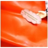 หนังเทียมสีส้มสดผิวหน้าลื่น แบ่งขาย 1 หน่วย = ขนาด1/4 หลา : 45X 65 cm