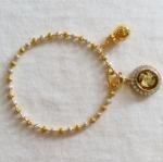 สร้อยข้อมือสองกษัตริย์เม็ดเล็กจี้กังหัน4ใบสีทองล้อมเพชรเสริมดวงค่ะ